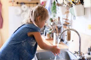 Girl Washing Hands at Sink